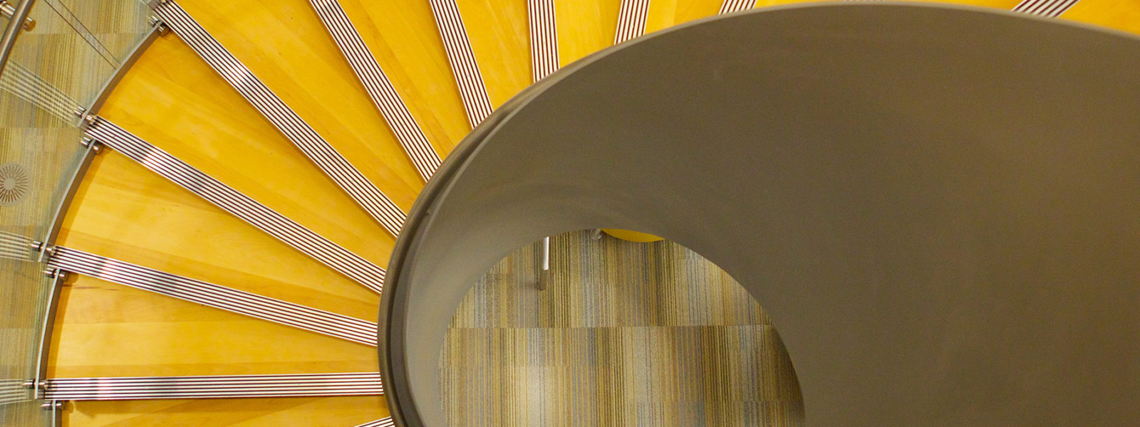 Modern Commercial Helical Stairway by Arcways Custom Stairs