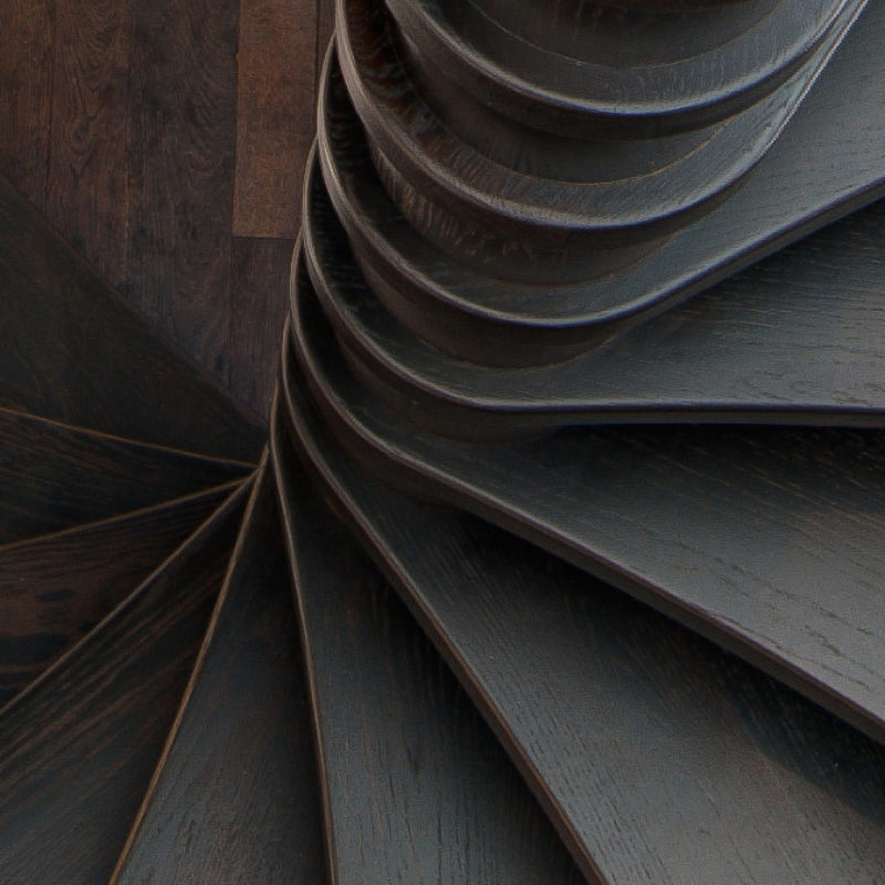 Modern Wood Spiral Stairway by Arcways Custom Stairs