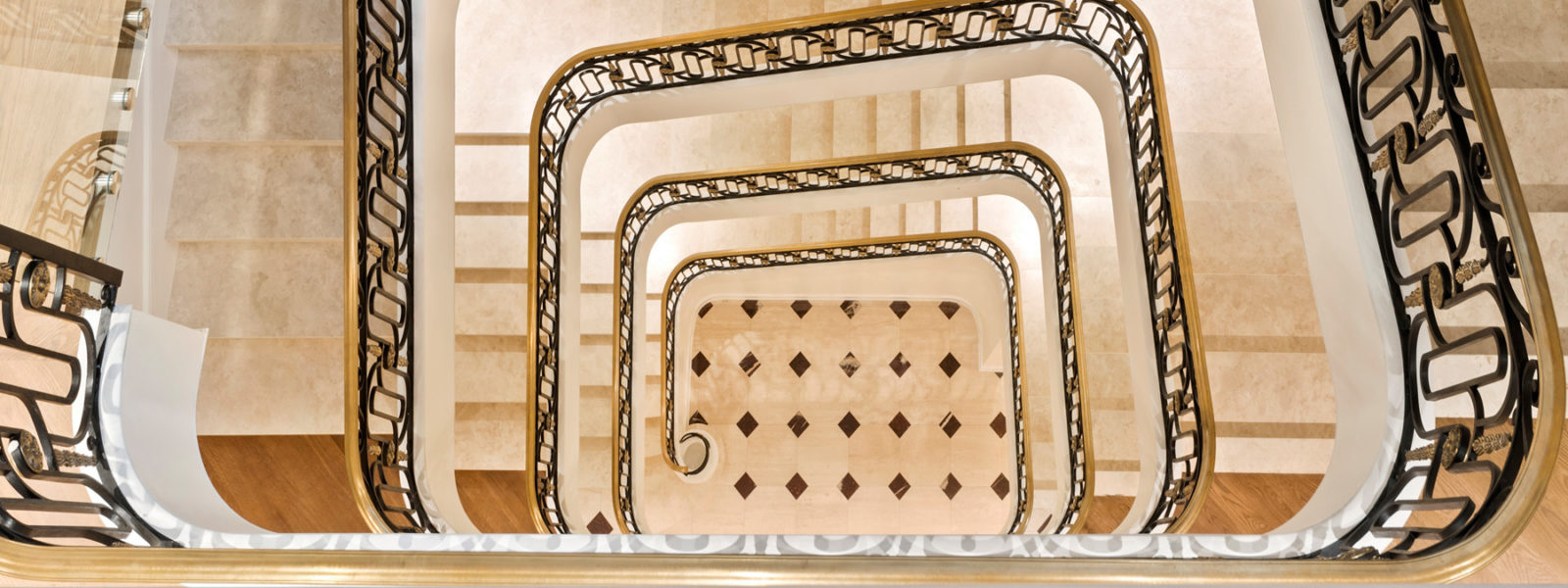 Stacked Four-Story Staircase in New York City Brownstone by Arcways Custom Stairs